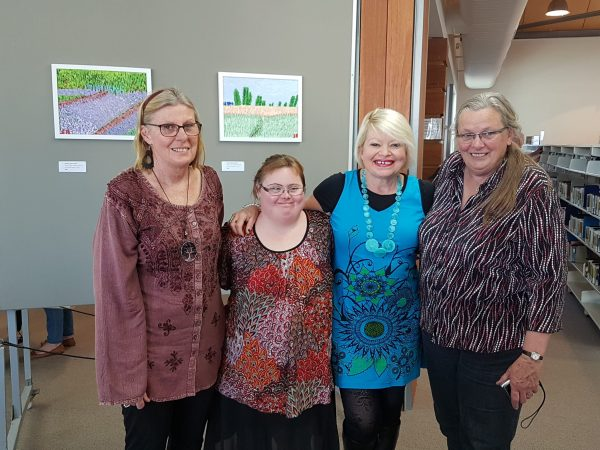 Sarah Bowkett (second from left) at her art exhibition last year.