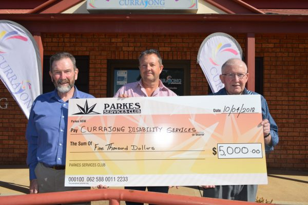 Parkes Services Club GM Denis Lane, Currajong CEO Jeff Evans and Parkes Services Club President Terry Knowles with the cheque donation.