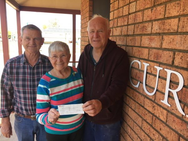 Kim Chambers and Helen Huntly of the Parkes Painting Group donating a cheque for $1000 to Neil Unger, CDS Chairman.