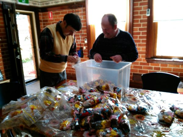 John Dwyer and Ross McMcCulloch preparing bags for Born to Read.