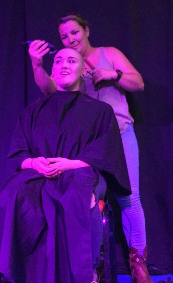 Trilbie Bermingham getting her locks chopped off