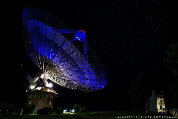 The Dish is lit blue for the event