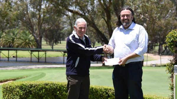 Forbes Golf club captain Steve Grallelis presents the charity day proceeds to Dane Millerd from Currajong Disability Services.