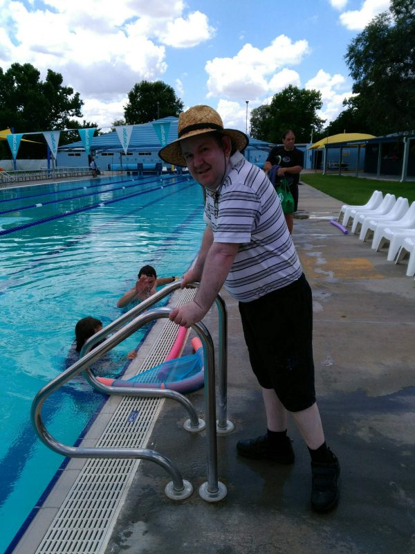Ross McCulloch standing by the pool on IDPwD in Forbes