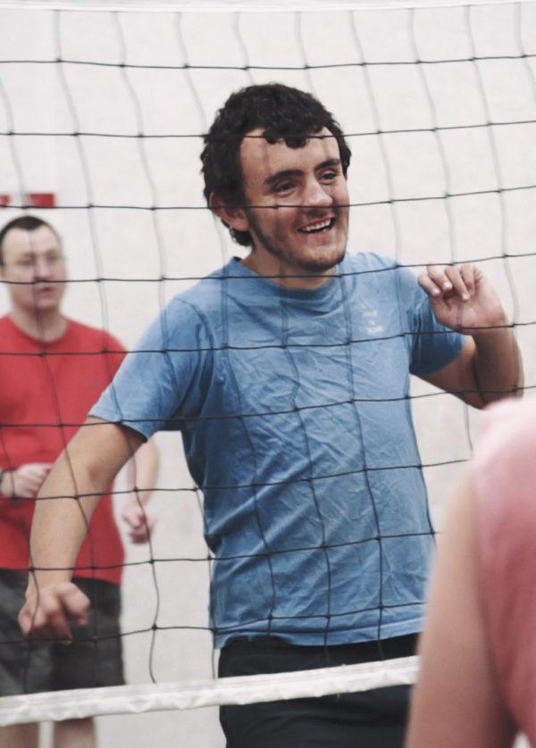 Thomas Davis playing volleyball.